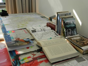 Image of desk with books and maps
