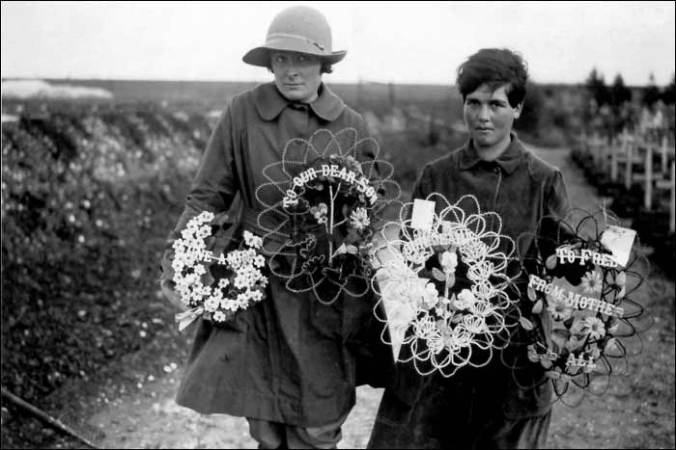 British women laying wreaths near Abbeville after the war.