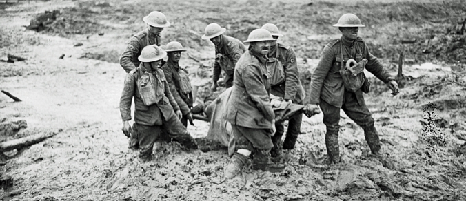 Stretcher bearers in mud