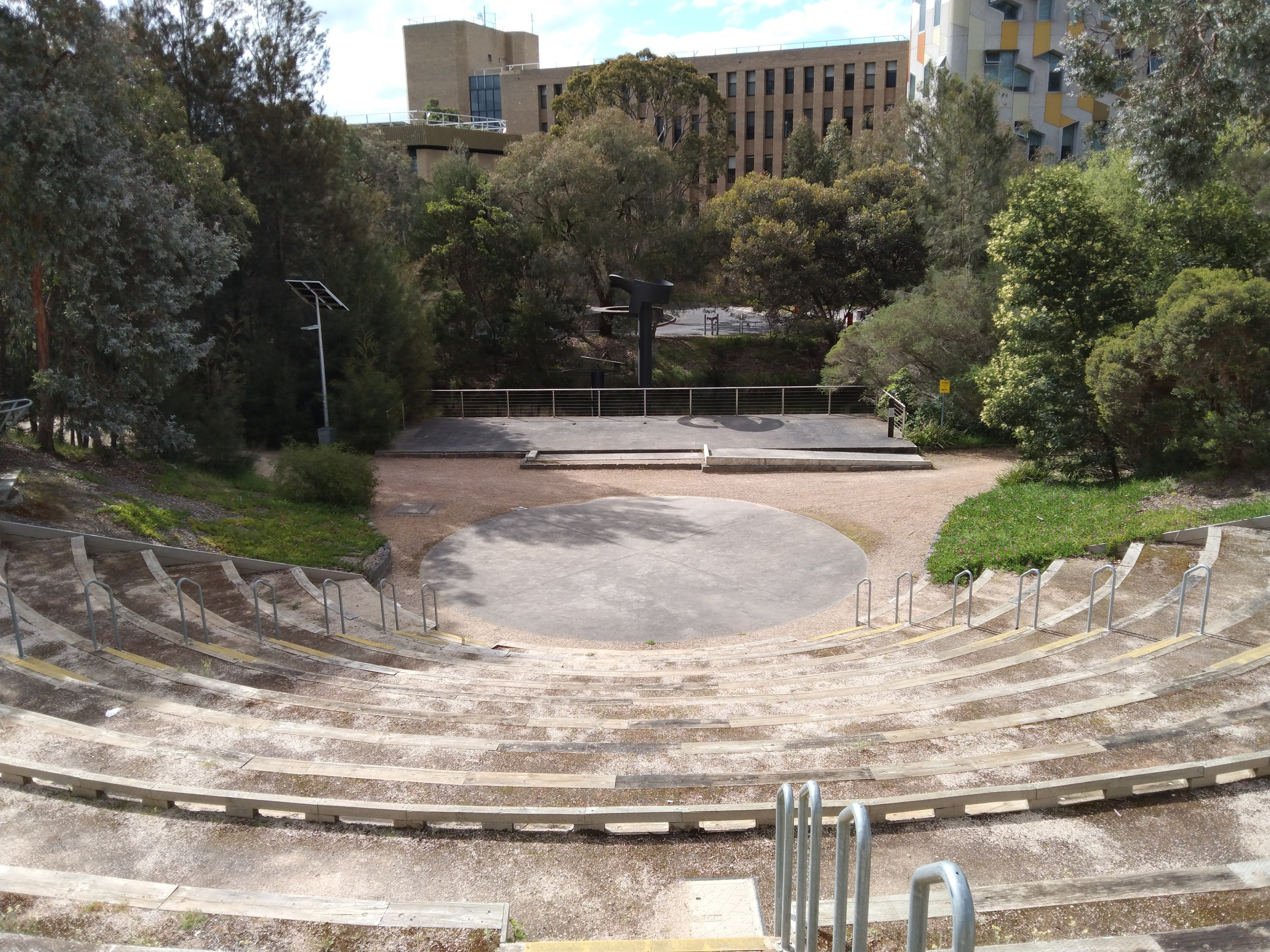 Theatre steps and stage looking across moat to buildings